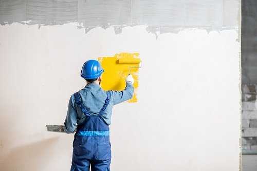 Residential Painting Contractor - Workamn painting wall indoors